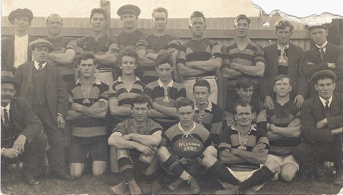 Ngakawau 1923 Junior Team Back Row (left to right) R. McCabe, Ned Crase, A McCabe, J. Dixon, W. Proctor, R.Crowley, C. Martin Second Row (left to right) S. Crase  (Selector) T. Laurie (Secretary), R. Bryant,  C. Johnston, D. McFarlane, J. Duffy, D. Theobold, R. McGill,   C. Turnbull (Coach)                                    Sitting I. Young, J.Harris, A. Mulholland.